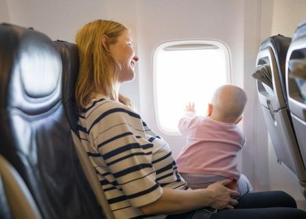 Mom with baby on airplane. Tips for air travel for nursing moms.