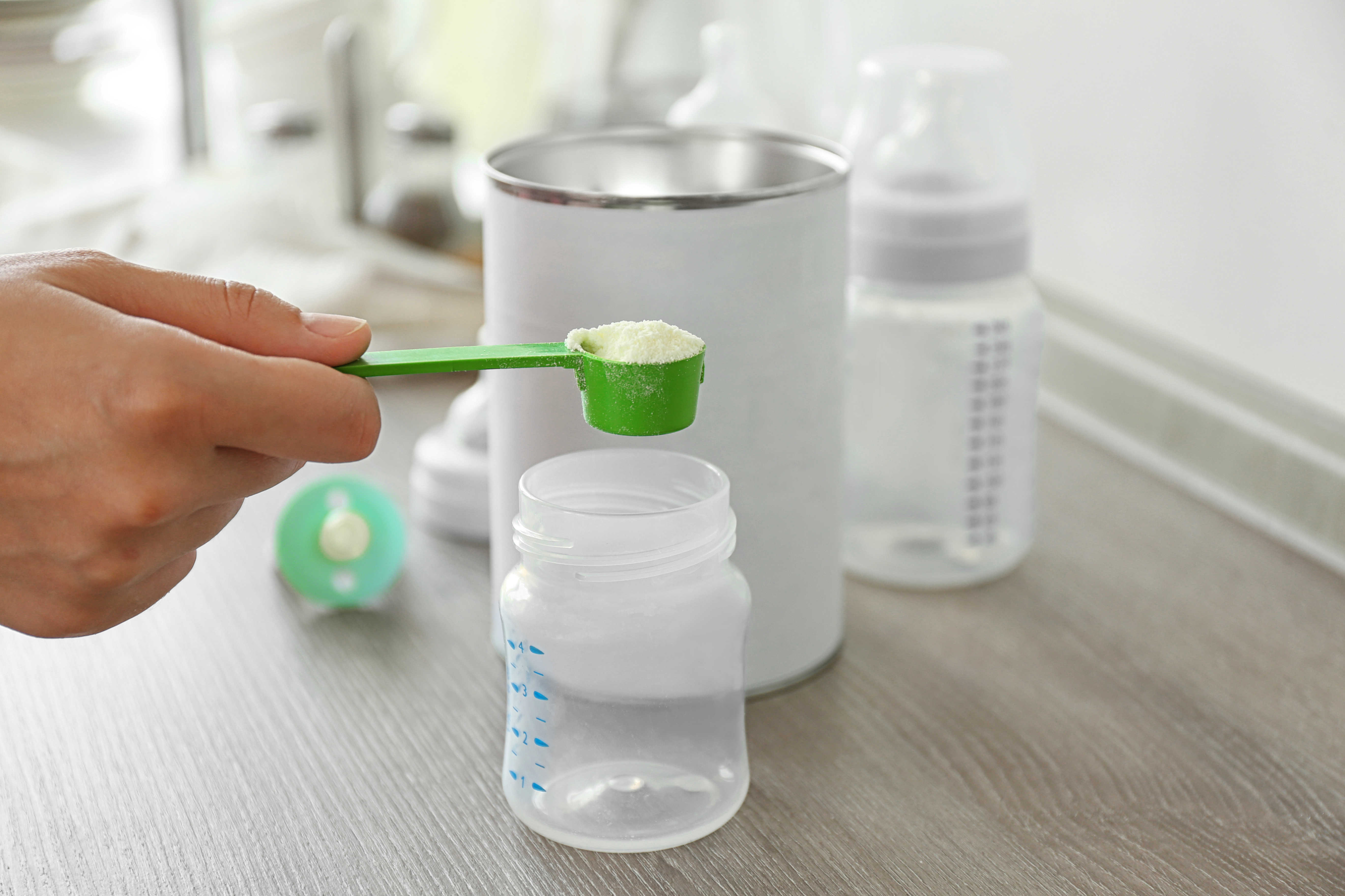 Formula measuring spoon, bottle, and can.