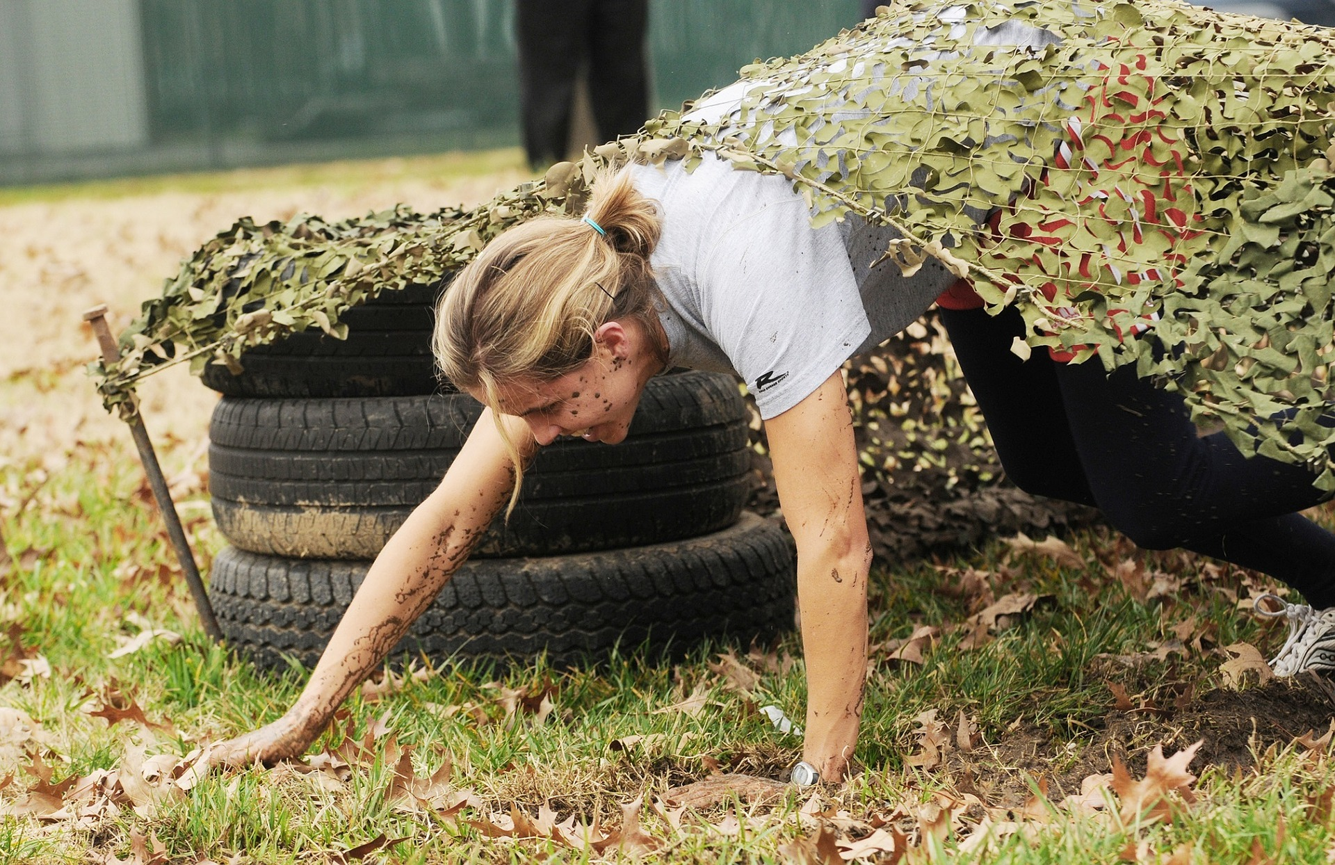 "Woman going through obstacle course overcoming ""have"" problems."