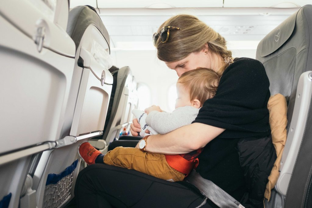 Mother with child during air travel