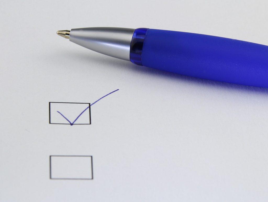 Mock assessment sheet and pen