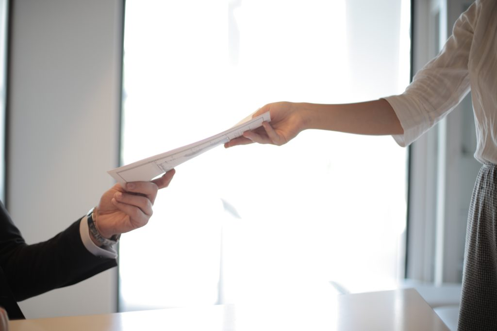 IBCLC-only job applicant handing over resume.