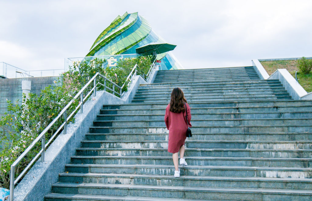 Woman in red dress on steps