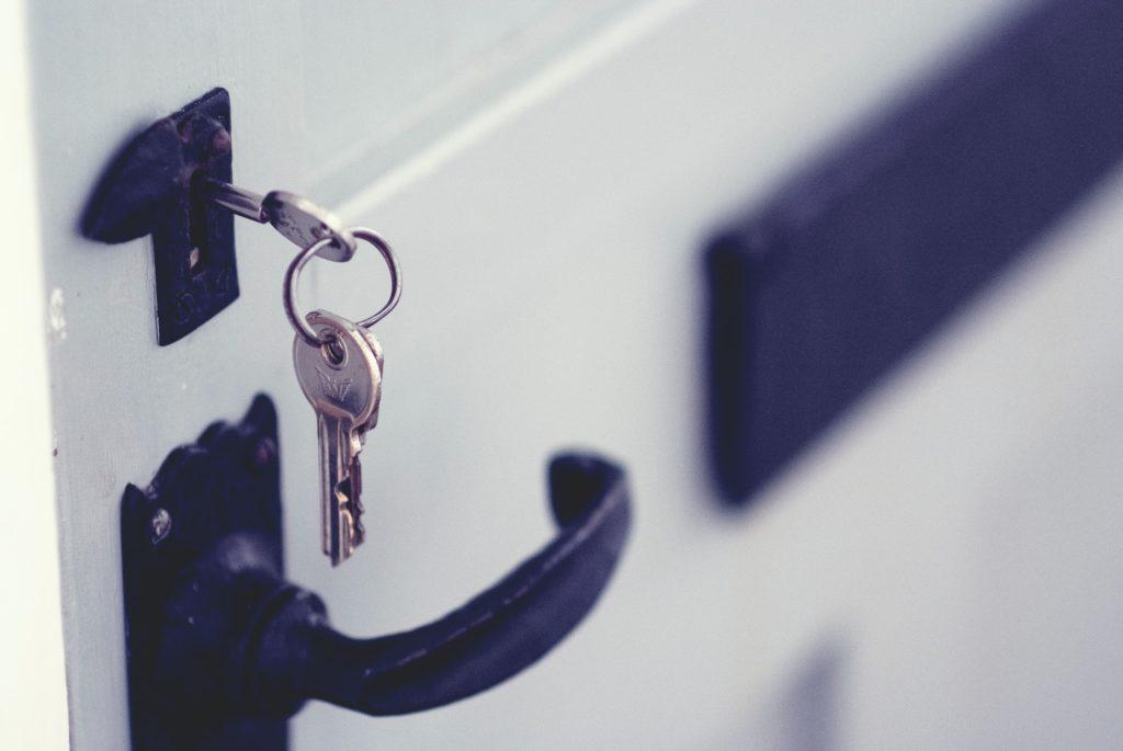 Keys in white door