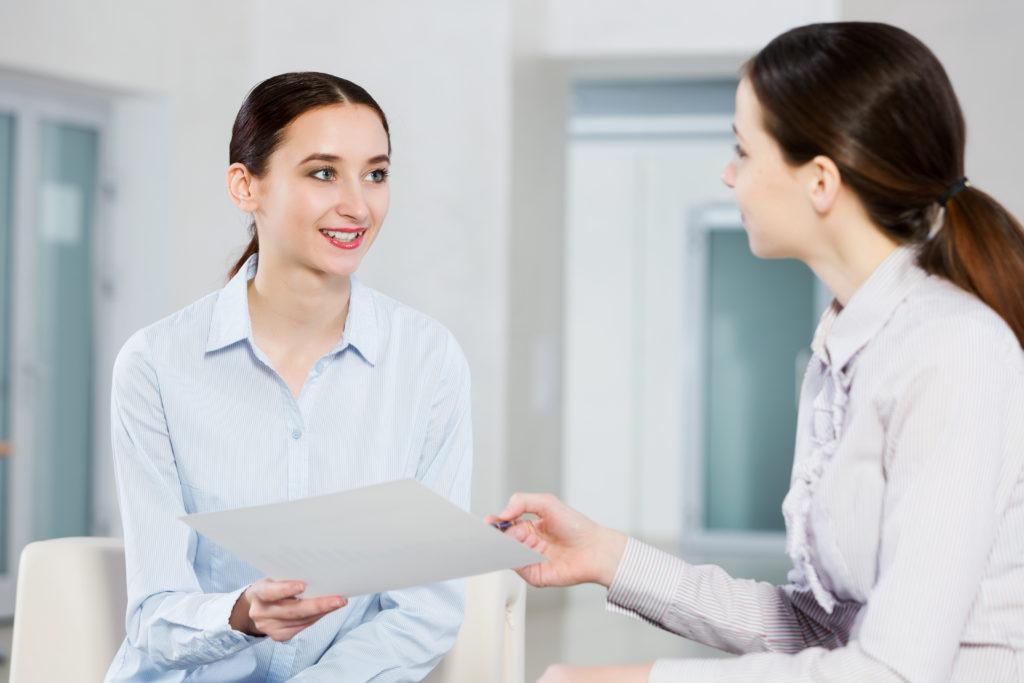 Women engaged in basic communication.