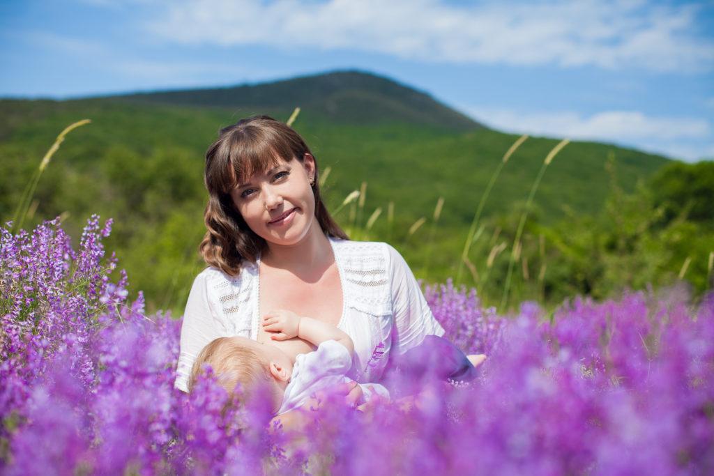Women in field of purple flowers breastfeeding in support of a healthier planet