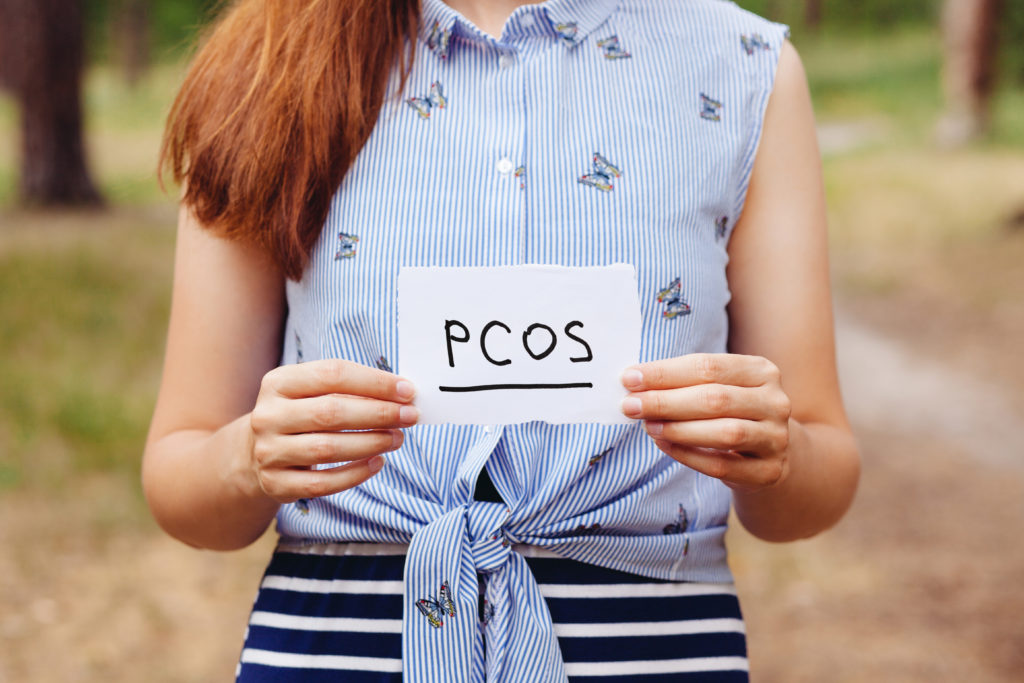Woman holding PCOS sign