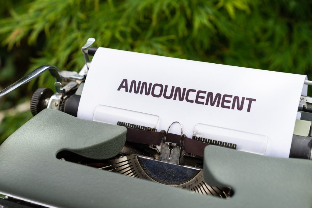 Typewriter with paper that says Announcement for key dates announcement.