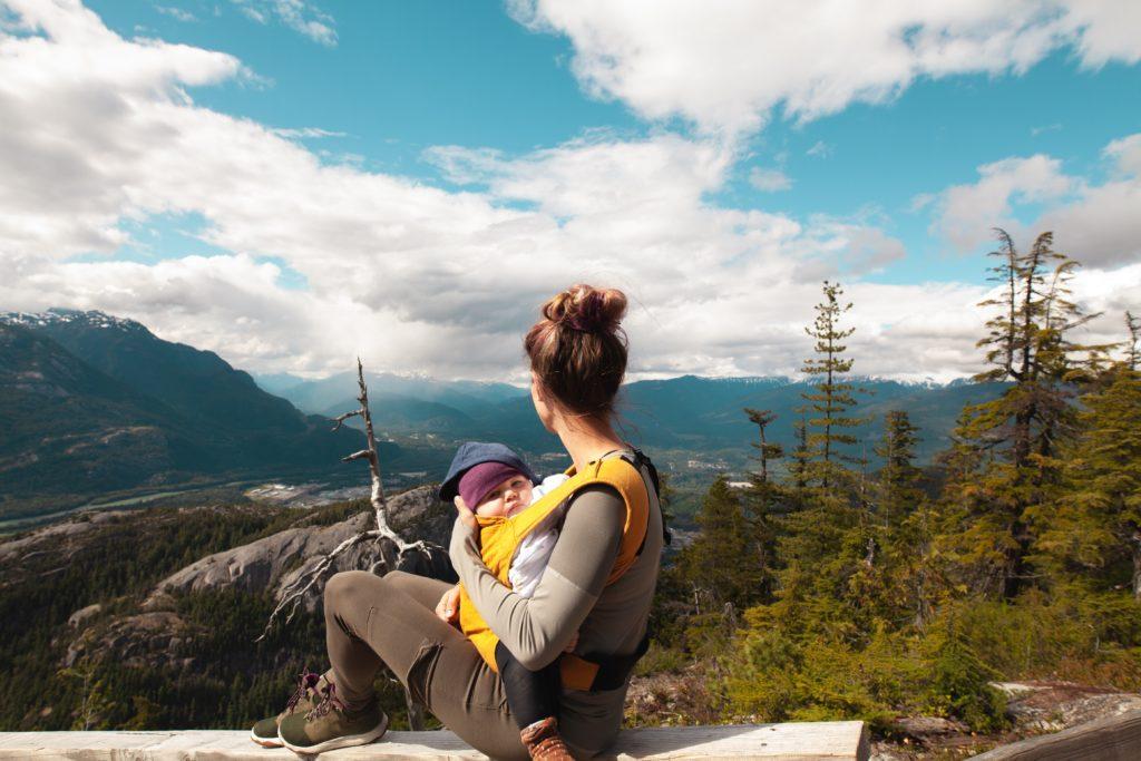 Woman babywearing on mountain