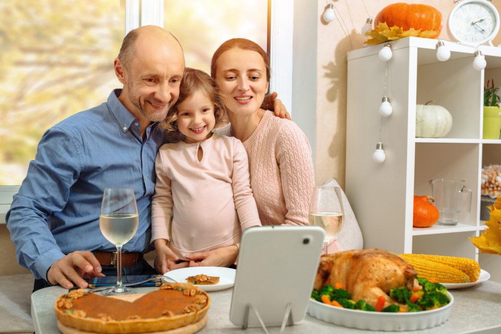 Family celebrating Thanksgiving virtually