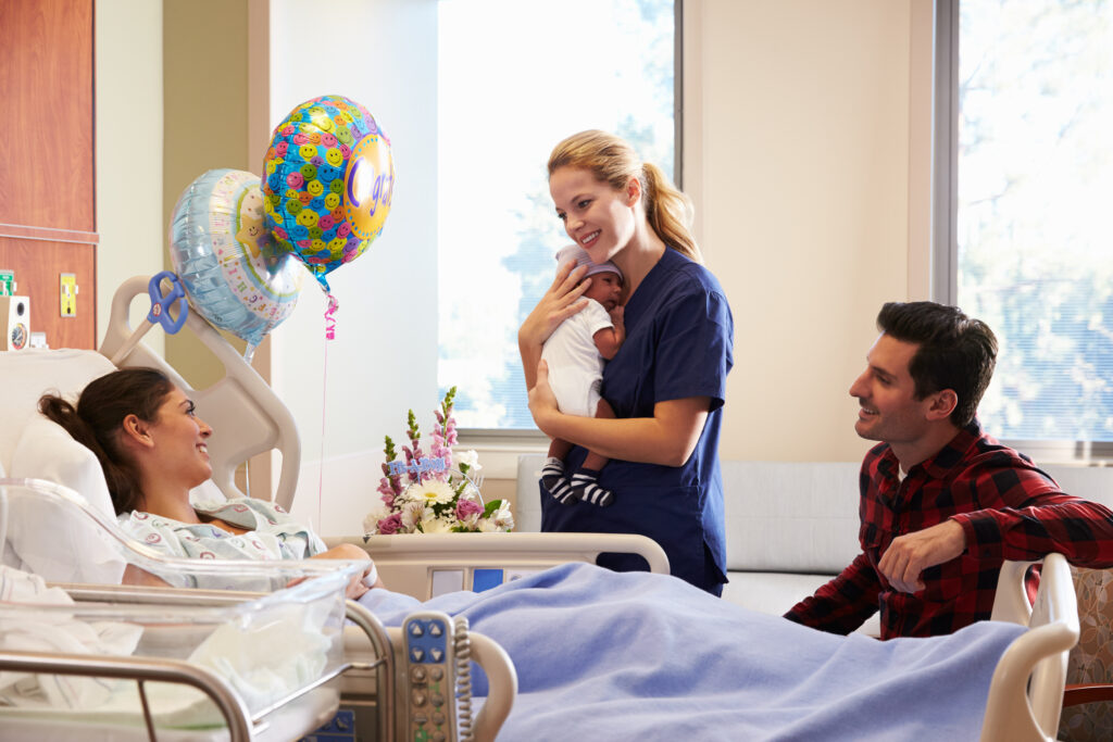 New parents with healthcare worker and baby in hospital.