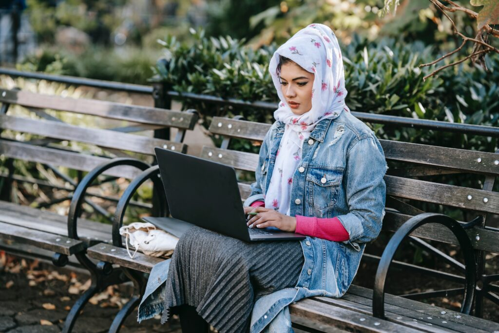 Woman sitting on bench considering options to study for IBLCE exam.