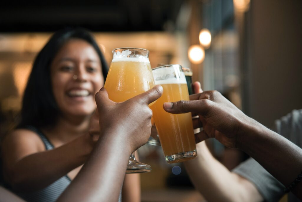 Friends raising glasses of beer