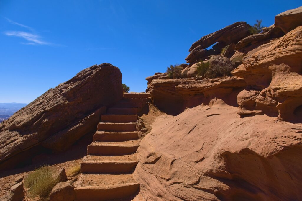 Steps carved in red rocks going upward.